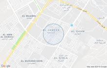 بنايه للبيع في حي الحسين  الشارع العام  مقابل مشويات ابو حسن في الجمعيات 2 محل ك