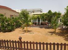 بيت عربي بموقع مميز في الشارقة ( الجزات ) للبيع