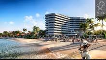 يقدم مشروع مينا شقق سكنية مفروشة بخدمات فندقية بإطلالات رائعة على مياه الخليج العربي