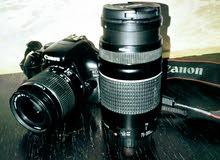كاميرا كانون 1100D مع عدستين