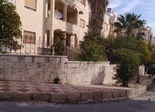 عمارة للبيع مع الأرض خلف الجامعة الاردنية