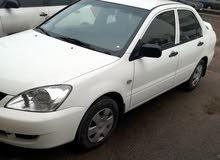 Renting Mitsubishi cars, Lancer 2013 for rent in Amman city