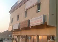 مبنى تجاري للبيع في مصفوت ارضى واول - عجمان ..تملك مواطن او خليجى فقط .@