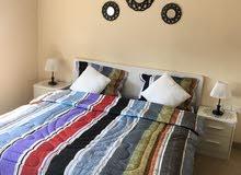 للبيع شقة مفروشة بالكامل ومؤجرة عبارة عن غرفة نوم في برج أمفا بالجفير