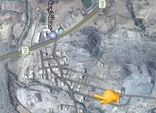 أرض في مخطط القمة محايل طريق رجال المع مقابل محطة نجمة الجنوب