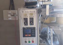 ماكينة تعبئة حجمية (نضام بوبات ) صينية درجة أولى للسكر والرز واشياء اخرة