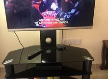 طاولة تلفزيون زجاج اسود