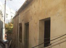 قطعة ارض مساحة 309 عليها بيت مستقل للبيع