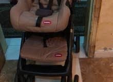 عربة وكرسي أطفال جونيور شبه جديد