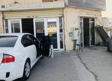محل زينة السيارات للبيع مع السجل والعامل