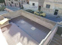 عمارة في حي نزال جبل الاخضر