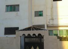 عمارة ثلاث طوابق قرب مدرسة الحسن