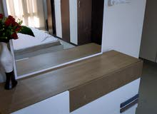 wardrobe,bed with matteess and dresser