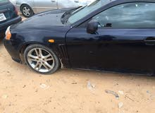 Blue Hyundai Tuscani 2005 for sale