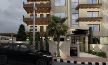 شقة ارضية في أرقى مناطق شارع المطار خلف كلية لومينوس
