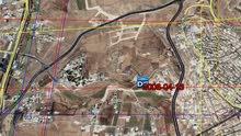 شقق قيد الانشاء بموقع مميز جداً واطلالة مرتفعة بأعلى نقطة كاشفة شارع المطار وحي الصحابة ودير غبار