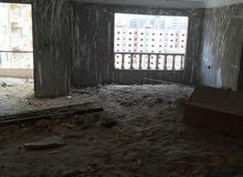 شقة للبيع بمدينة نصر 250م بالمنطقة السادسة نصف تشطيب بعمارة حديثة