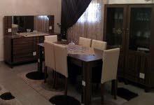 غرفة أكل متكاملة مع طاولة تلفزيون