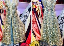 designer floor touching dress