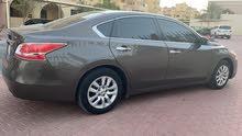 نيسان التيما 2.5l  فل اتماتيك موديل 2014 للبيع Nissan Altima 2014 brown 2.5L