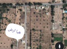 قطعة ارض للبيع في طريق المطار بعد كوبري الفروسية تاني شارع علي ايمين طريق مشروع