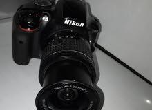 كاميرا نيكون D 3300 اخت الجديدة كارتونة موجودة للبيع او مراوسة بموبايل
