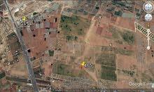 ارض للبيع الطنيب 665 متر على شارعين