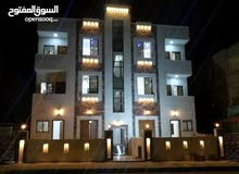 شقة طابق ثاني بالعاشرة الغربي رديف شارع الكويت بسعر مميز