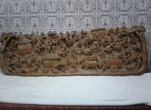لوحة فنية منحوتة على الخشب