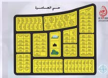 تملك ارضك التجارية بجانب ابراج الامارات على شارع الشيخ محمد بن زايد والتملك حر