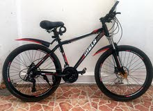 (mountain bike used only for 2 weeks good condition MGLH)(قابل للتفاوض)