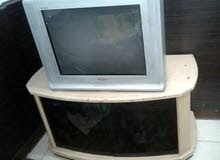 تليفزيون + طاوله