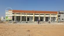 للبيع مبنى محلات تجارية بدفعات ميسرة من المالك فى الياسمين عجمان عائد مميز للاستثمار