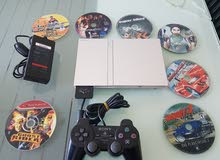 PS2 Slim  PAL with one controller + 15 games