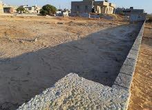 قطعة أرض في بوصنيب ضي ومية واصلات مساحة 1500 علي شارع  14متر
