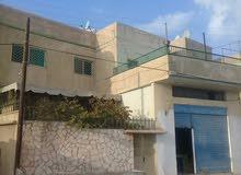 عمارة طابقين - الزرقاء _حي الملك طلال
