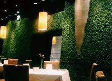 عشب جداري صناعي لتنسيق و تزين الحدائق و مداخل البيوت