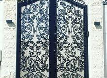 عمل احدث تصاميم أبواب الحديد والالومنيوم