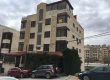 شقة + روف للبيع شارع علي العبدالات موازي لشارع الاْردن