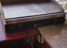 معدات وأدوات وأجهزة وثلاجات مطاعم