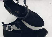 حذاء/بوت أسود