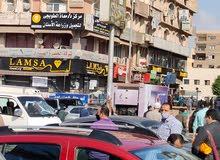 محل للبيع بمول الأمريكية بقلب الحصري يري المسجد مؤجر ب40الف