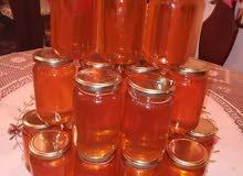 عسل ربيعي طبيعي 100% بيع جمله لي نصف الكيلو 20 دينار ولي قطاعي 23