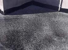 اسطي قطران لتشطيب سقف البيت ومنعه من التسريب المياه
