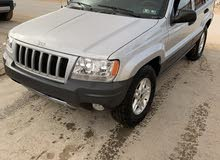 For sale 2004 Grey Grand Cherokee