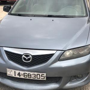 Used condition Mazda 6 2003 with +200,000 km mileage
