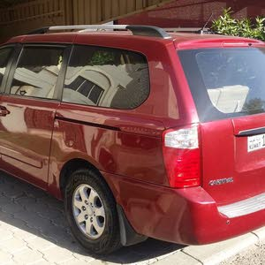 Red Kia Carnival 2010 for sale