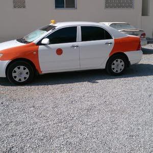 كورولا تاكسي للبيع بشكل عاجل وبقيمه معقوله موديل 2005 مطلوب 1000