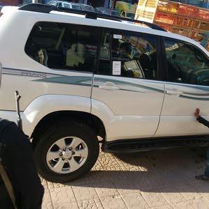 تويوتا برادو 2004لون أبيض نظيف جدا مجمرك تم تخفيض السعر لفتره محدده