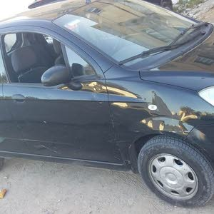 Black Chevrolet Spark 2011 for sale